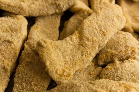breadcrumbs: fish fillets coated in breadcrumbs