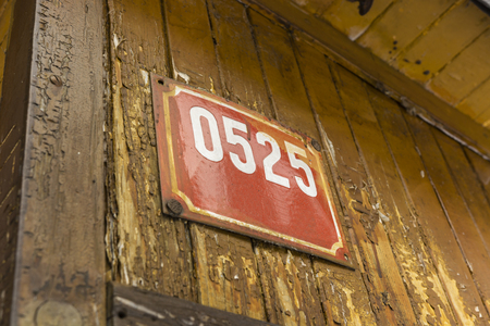 descriptive: descriptive signs with numbers on wooden building Stock Photo
