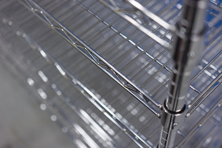 metallic stainless wire shelves on the trolley