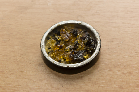 solder: rosin solder material in a metal cup