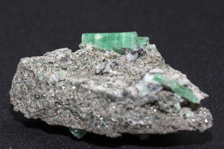 emerald stone: crystal emerald in the detail view with Matt Stone Stock Photo