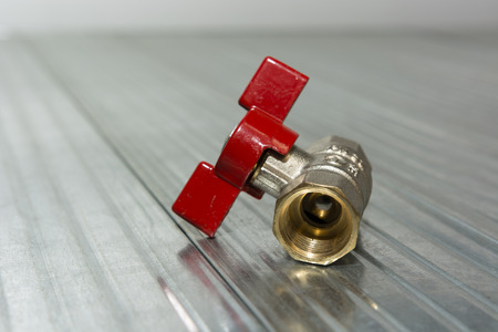 gas ball: Small ball valve with red butterfly handle Stock Photo