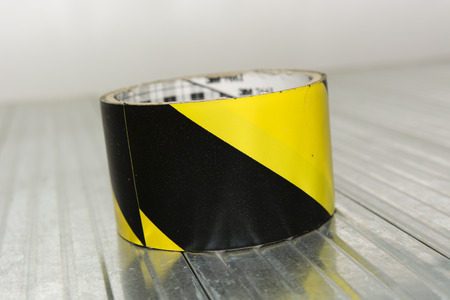 broad: black and yellow adhesive tape broad Stock Photo
