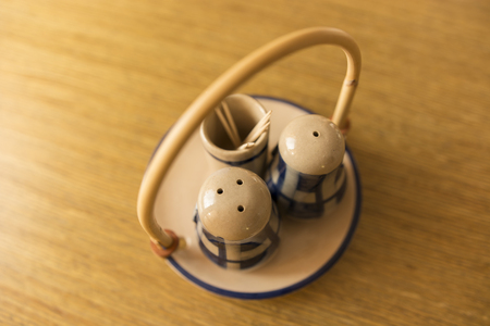 salt shaker: ceramic salt shaker and pepper shaker with undertrays