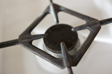 splitter: gas burner on the stove with a metal support Stock Photo