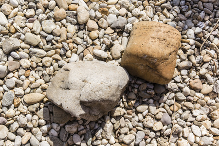 smaller: two stones lying on smaller stones