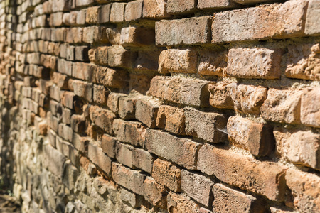 unprotected: brick wall without plaster with crumbling bricks