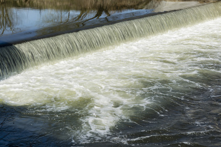 artificially: A small waterfall on the river artificially created