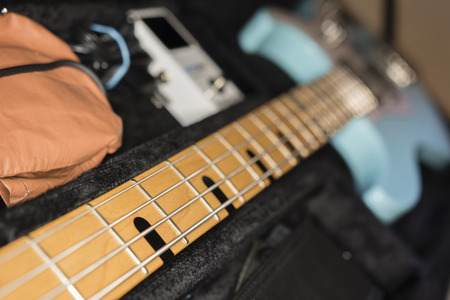 fits in: view of the guitar neck to look at the whole guitar case in ITS Stock Photo