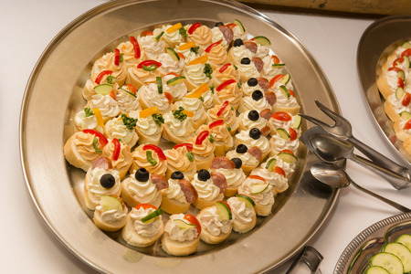 poised: Bowl with canape ? s with cream.