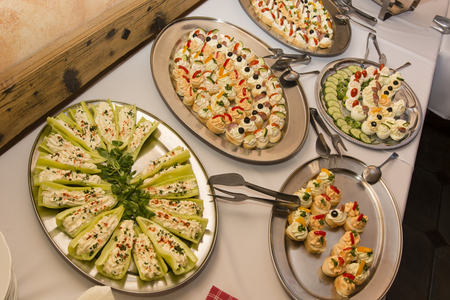 poised: ? Bowl with canape with cream on the buffet tables. Stock Photo