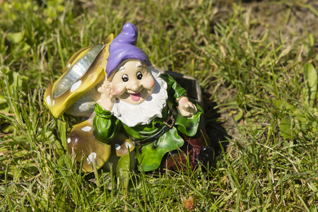 bedside lamp: Dwarf as a bedside lamp lying in the grass