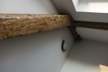plasterboard: old wooden beam with the light on plasterboard walls