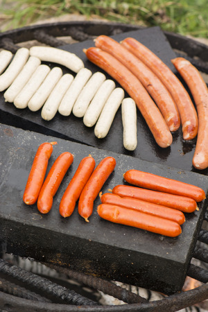 frying: Frying sausages at barbecues.