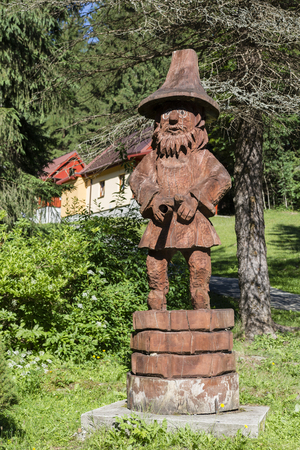 carved: Carved wooden statue of a robber.
