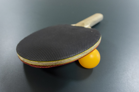 racquet: Table tennis racquet with a ball on the table. Stock Photo