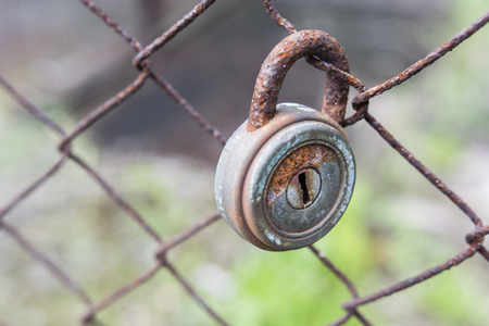 Padlock on the fence. Stock Photo