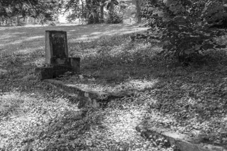 headstone: Old grave with a headstone.