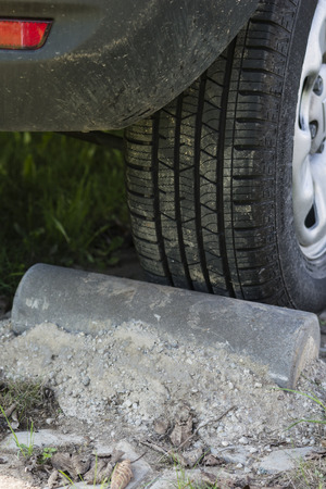 bollard: Concrete bollard to lock car parking.
