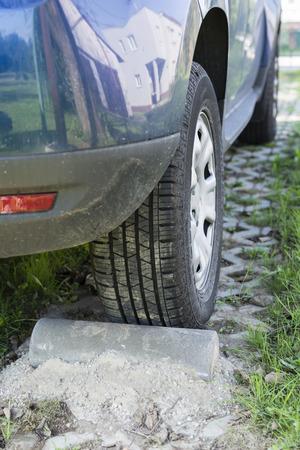 Concrete bollard to lock car parking.