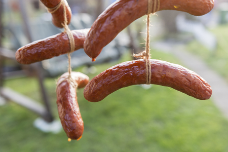 cooling: Cooling with smoked sausage. Stock Photo
