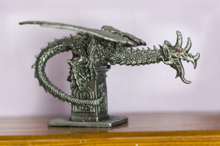 Pewter dragon figurine on the landing. Stock Photo