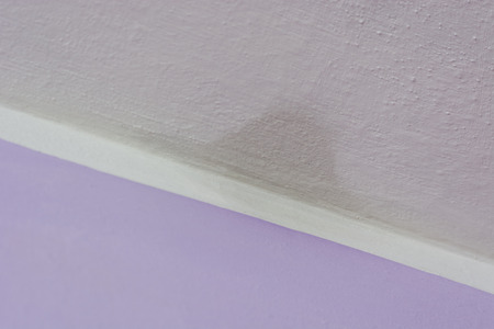 Moisture on the wall in the corner of the interior.