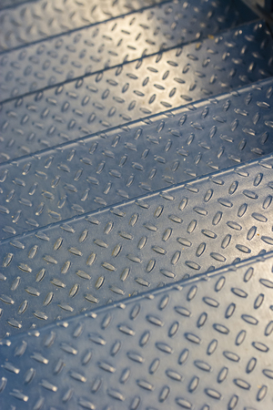 perforation: Perforation on the metal staircase.