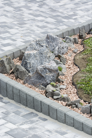 Artificially created rocks with side palisades and lawns. Stock Photo