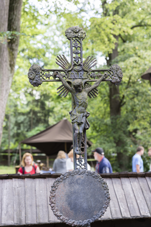 Old metallic cross in a cemetery with religious Christian themes. Editorial