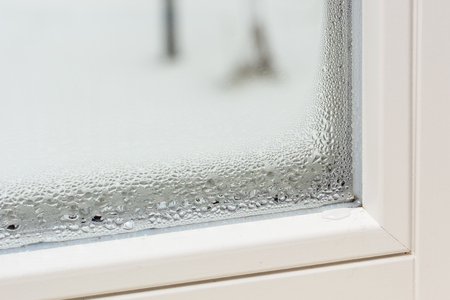 Deposition - Water drops on the window. Stock Photo