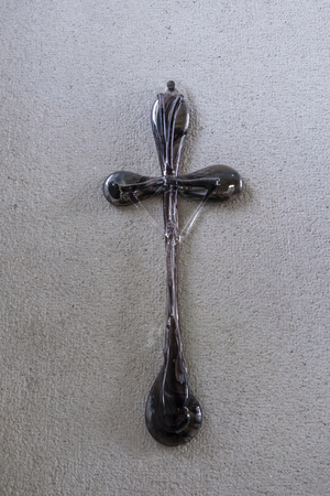 A glass cross with Jesus on the wall. 写真素材