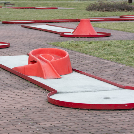 Miniature golf in red without people.
