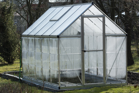 Plastic dewatered greenhouse in the garden.