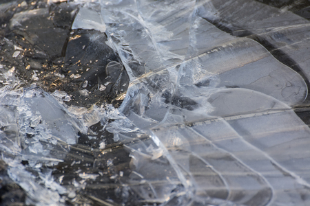 Ice crust on the surface of the pool. Imagens