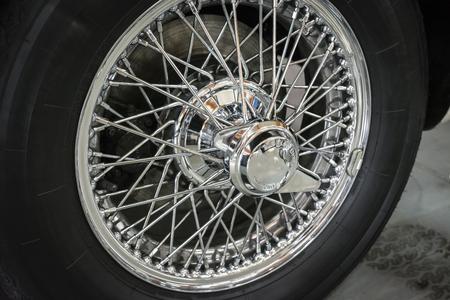 Chromed car wheel strut.