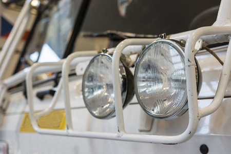 Additional headlamps with a cover frame on a truck.