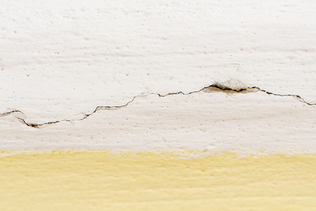 Crack in the wall over painting at the ceiling.