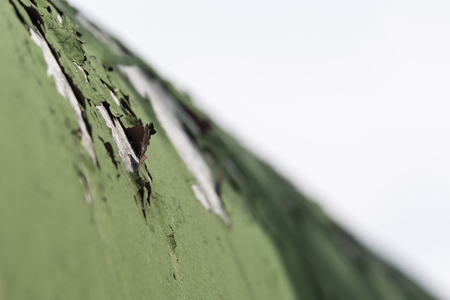 Peeling green on galvanized sheet metal.