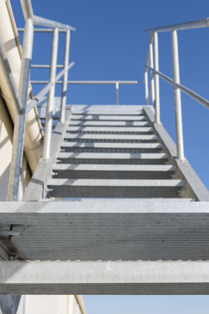 Metal Grate Staircase Galvanized On The Outside Of The Building. Stock  Photo   101865988