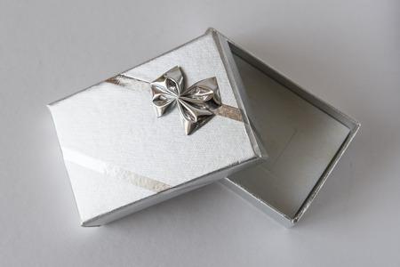 Open gift box silver.