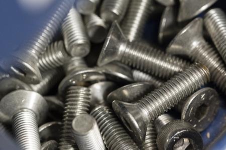 Stainless steel countersunk screws. Banco de Imagens - 102959354