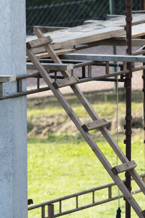 Hand made wooden ladder at the construction. Stock Photo