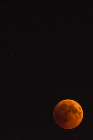 A moon in the night sky during an eclipse. Stock Photo