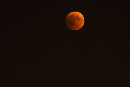 A moon in the night sky during an eclipse. Stock Photo - 106093633