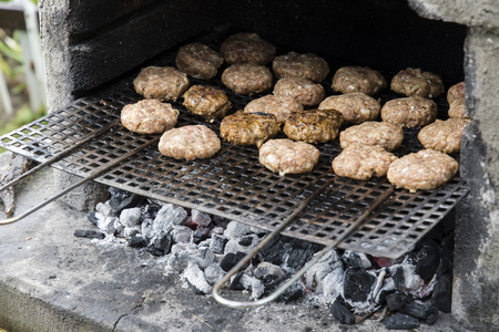 Small meatballs on grill.