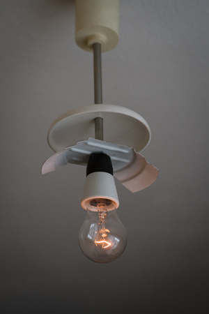 Fired filament in bulb on ceiling light.