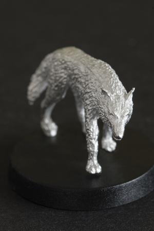 Tin figure miniature wolf. Banco de Imagens - 118589239