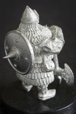Tiny dwarf figure in detail. Stock Photo