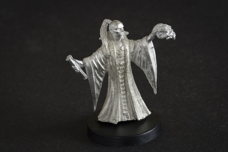 Tin figure of a magician with a crossbow.